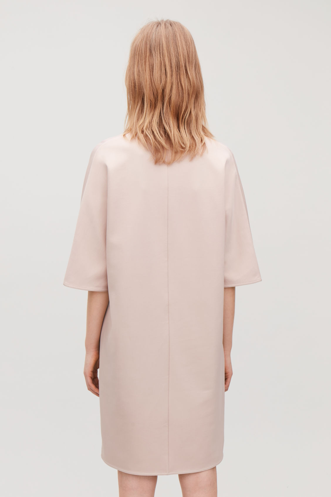 Model side image of Cos batwing-sleeved jersey dress  in brown
