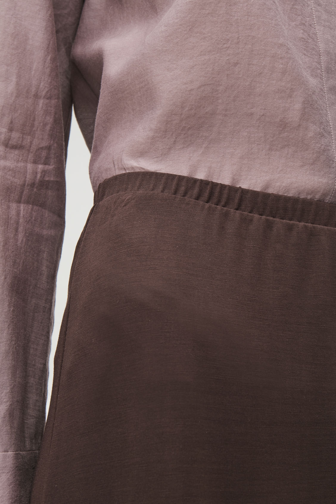 Model side image of Cos elastic-waist jersey trousers  in brown