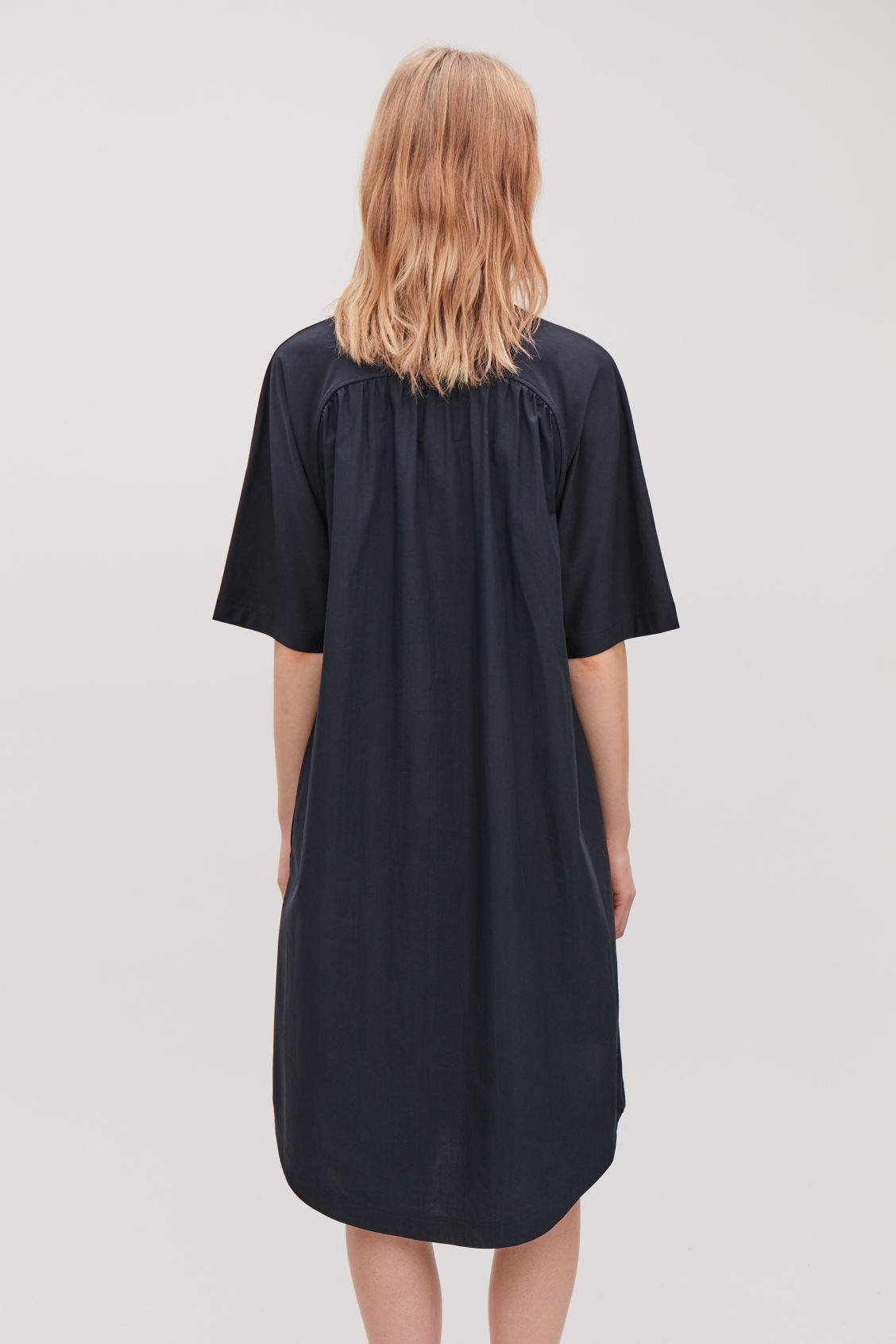 Model side image of Cos woven-panelled a-line jersey dress in blue