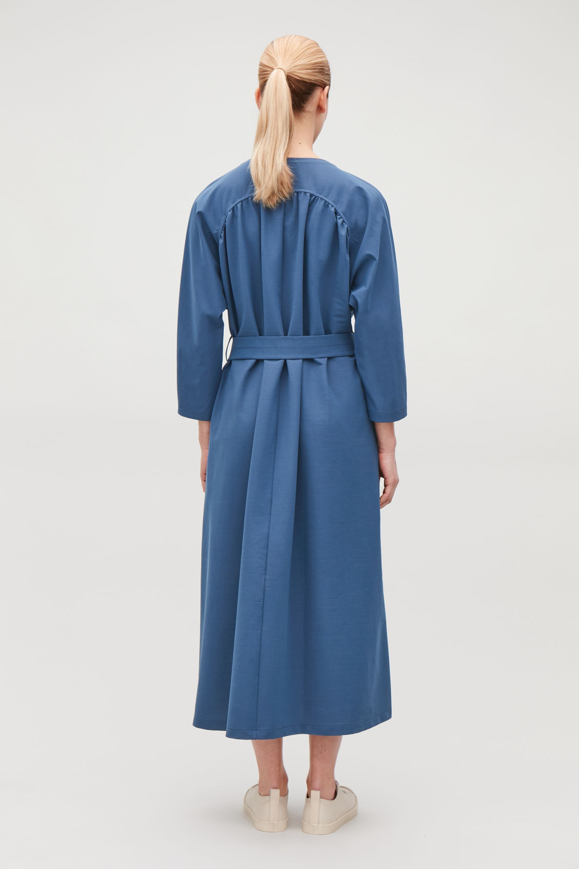 Model side image of Cos yoke-detailed gathered dress in blue
