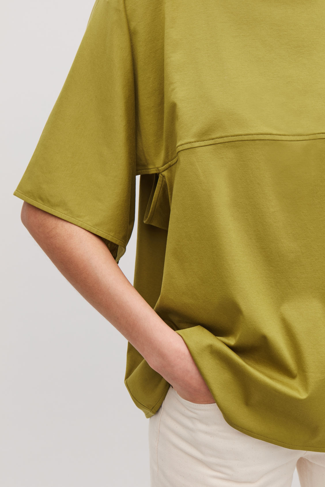 Model side image of Cos square-neck jersey top in yellow