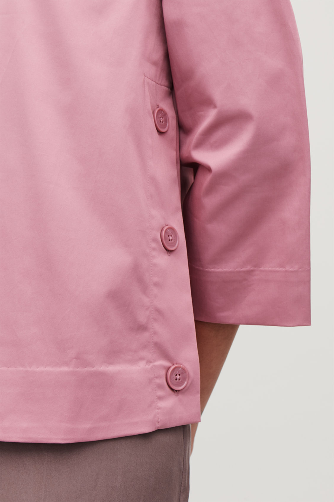 Model side image of Cos cotton top with button detail  in pink