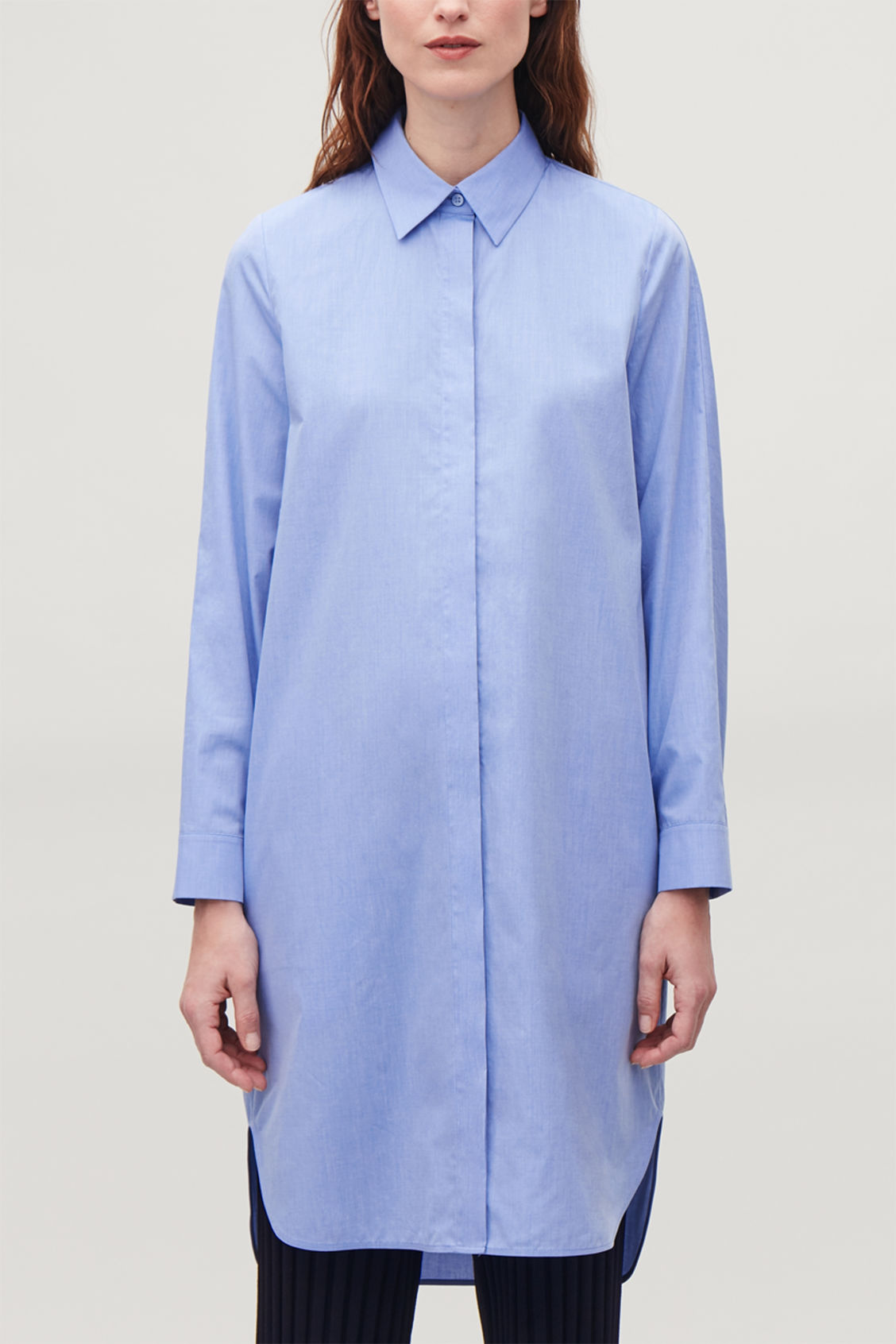 Model side image of Cos  fil-a-fil cotton shirt dress in blue