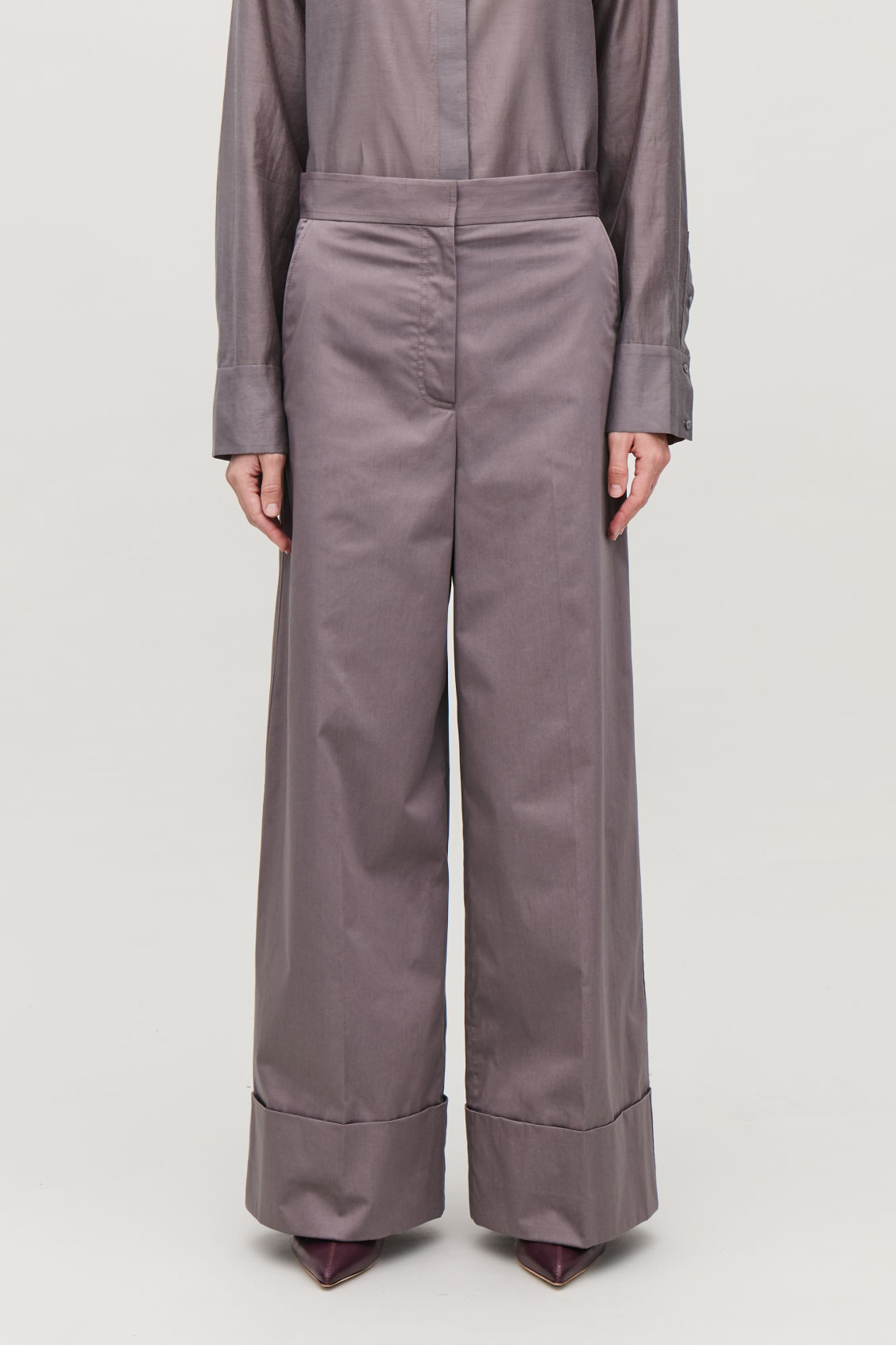 Model side image of Cos wide-leg cotton trousers in purple