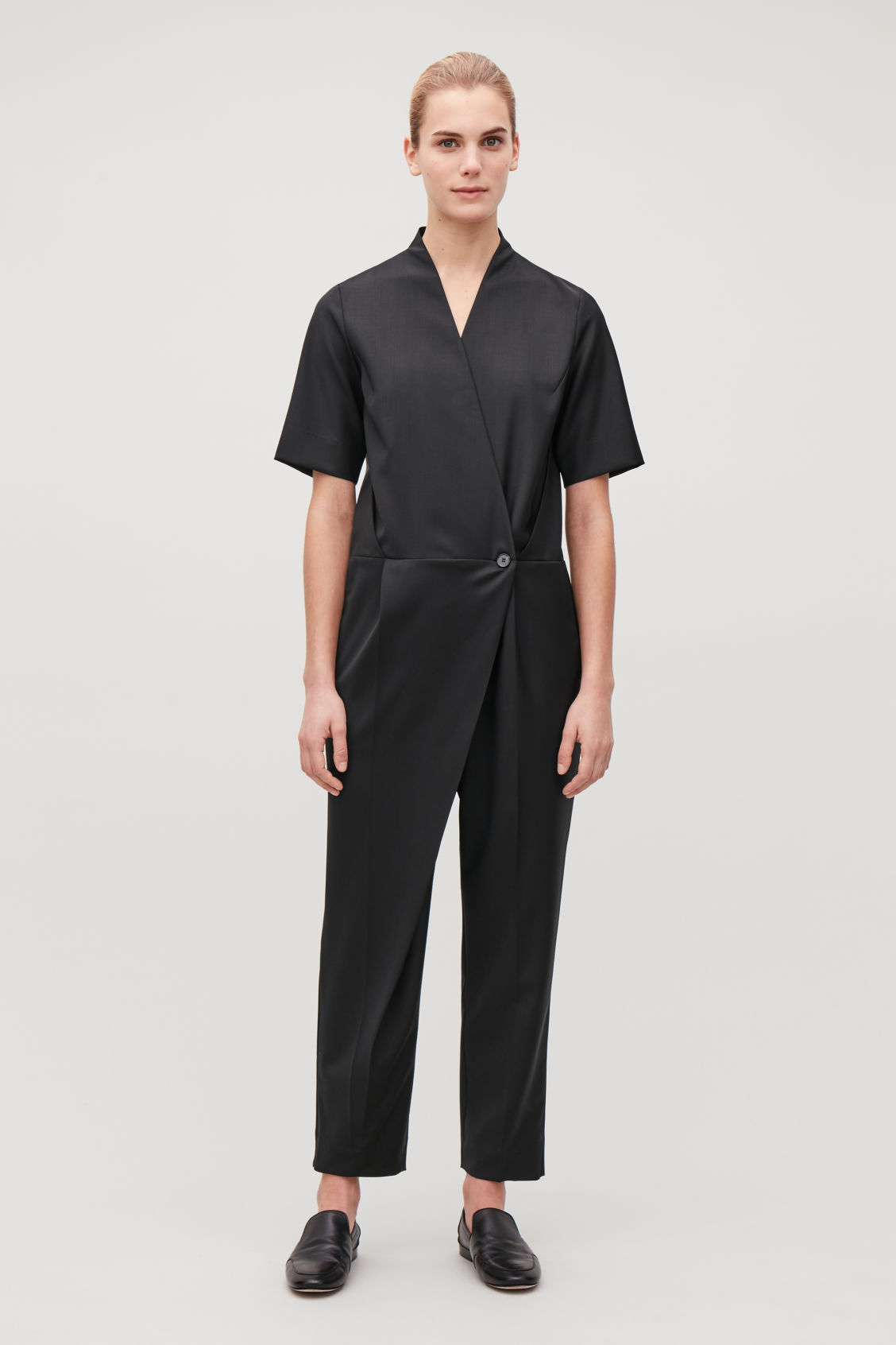 Model front image of Cos wool tailored wrap jumpsuit in black