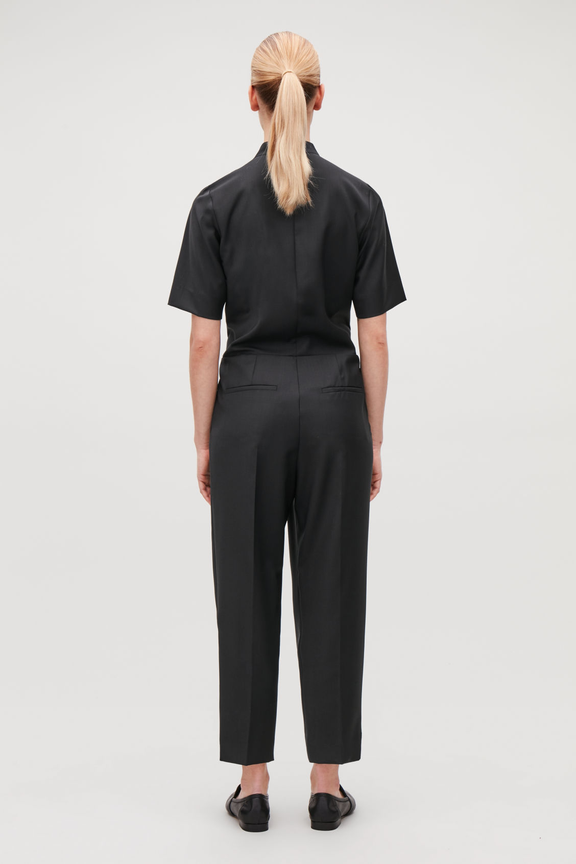 Model side image of Cos wool tailored wrap jumpsuit in black