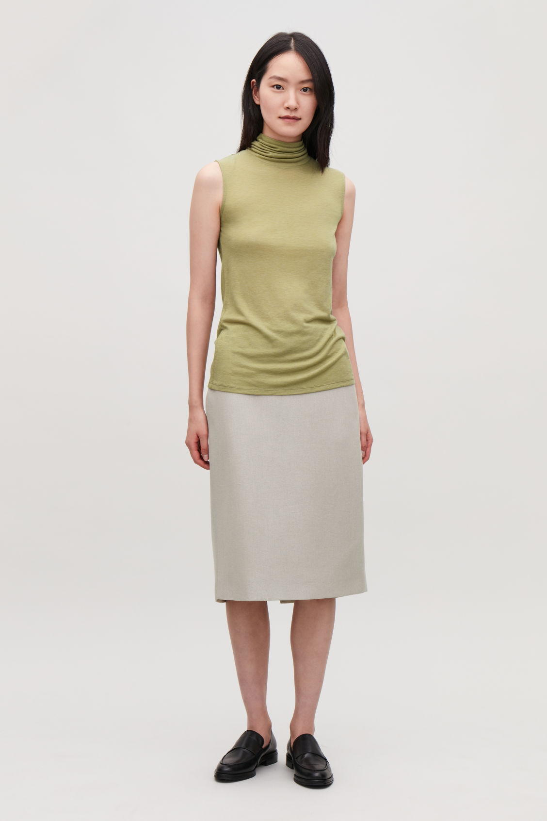Model front image of Cos sleeveless roll-neck jersey top in green