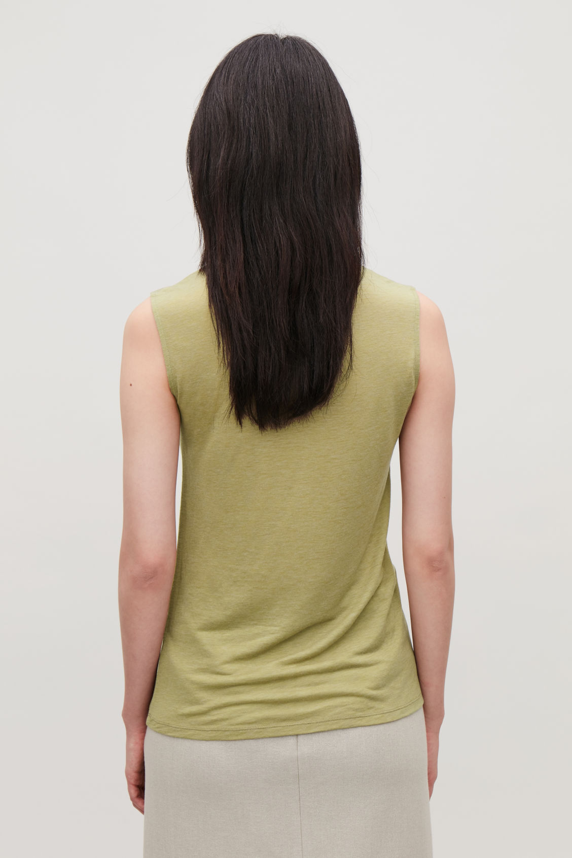 Model side image of Cos sleeveless roll-neck jersey top in green