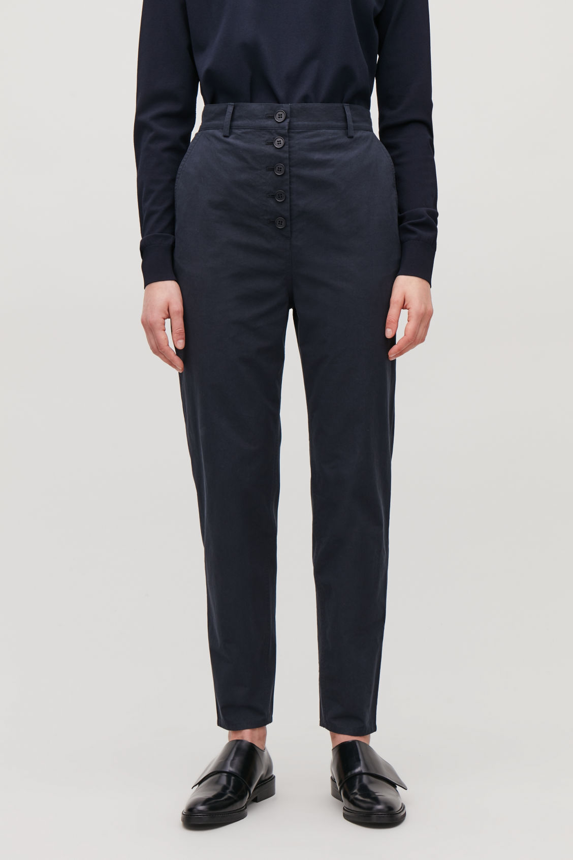 Model side image of Cos button-up cotton chinos in blue