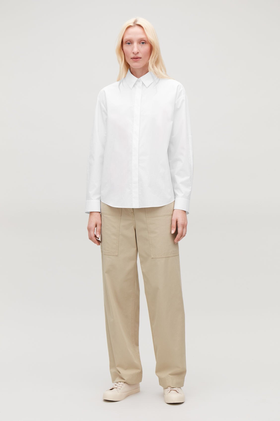 Model front image of Cos straight-leg trousers with pockets in beige