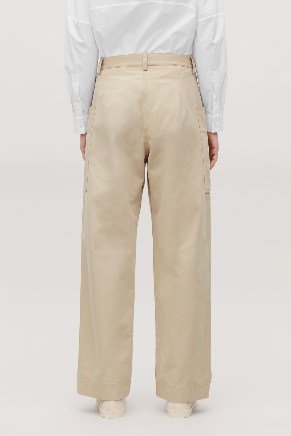 Model side image of Cos straight-leg trousers with pockets in beige