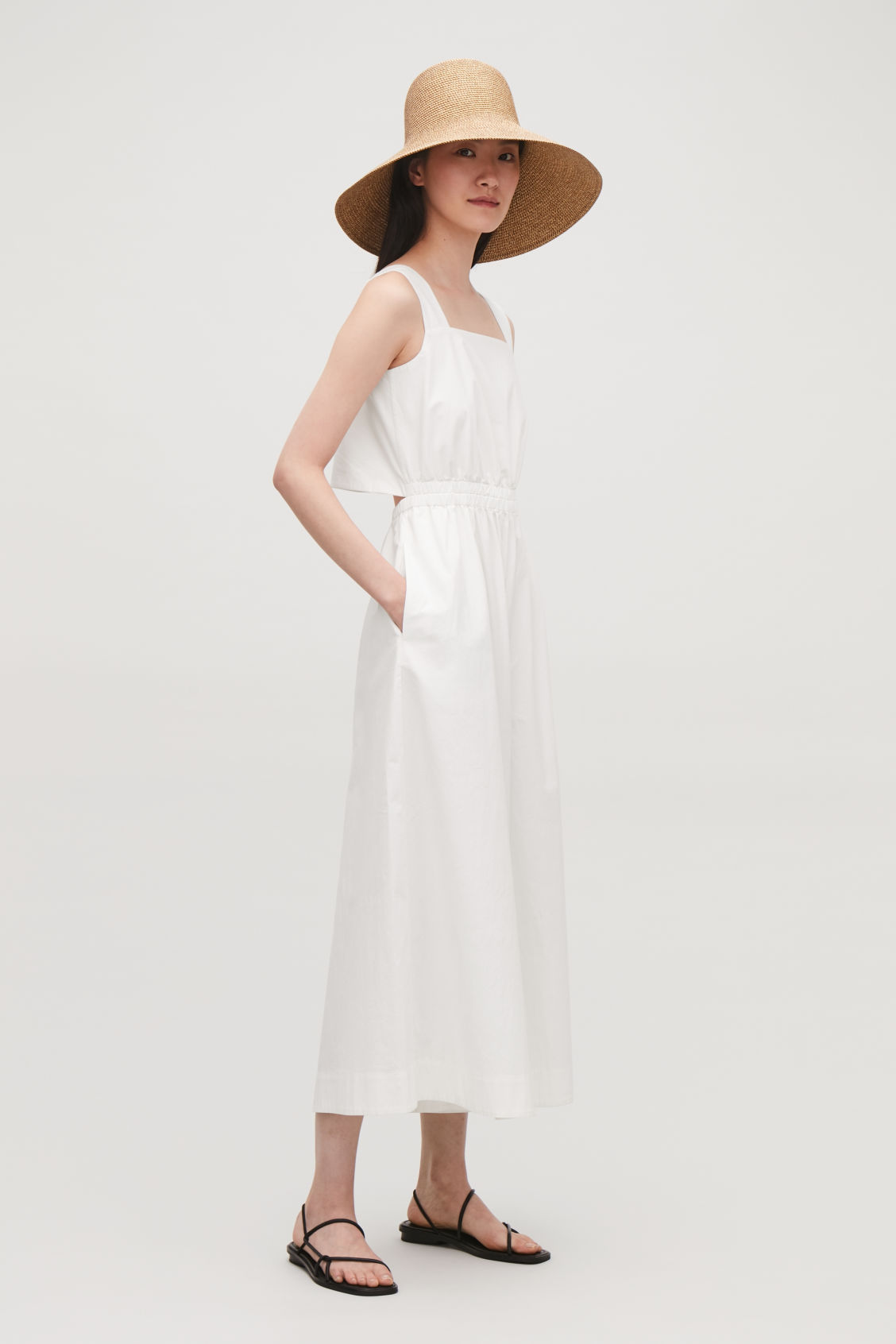 Model side image of Cos wide-leg cotton jumpsuit  in white