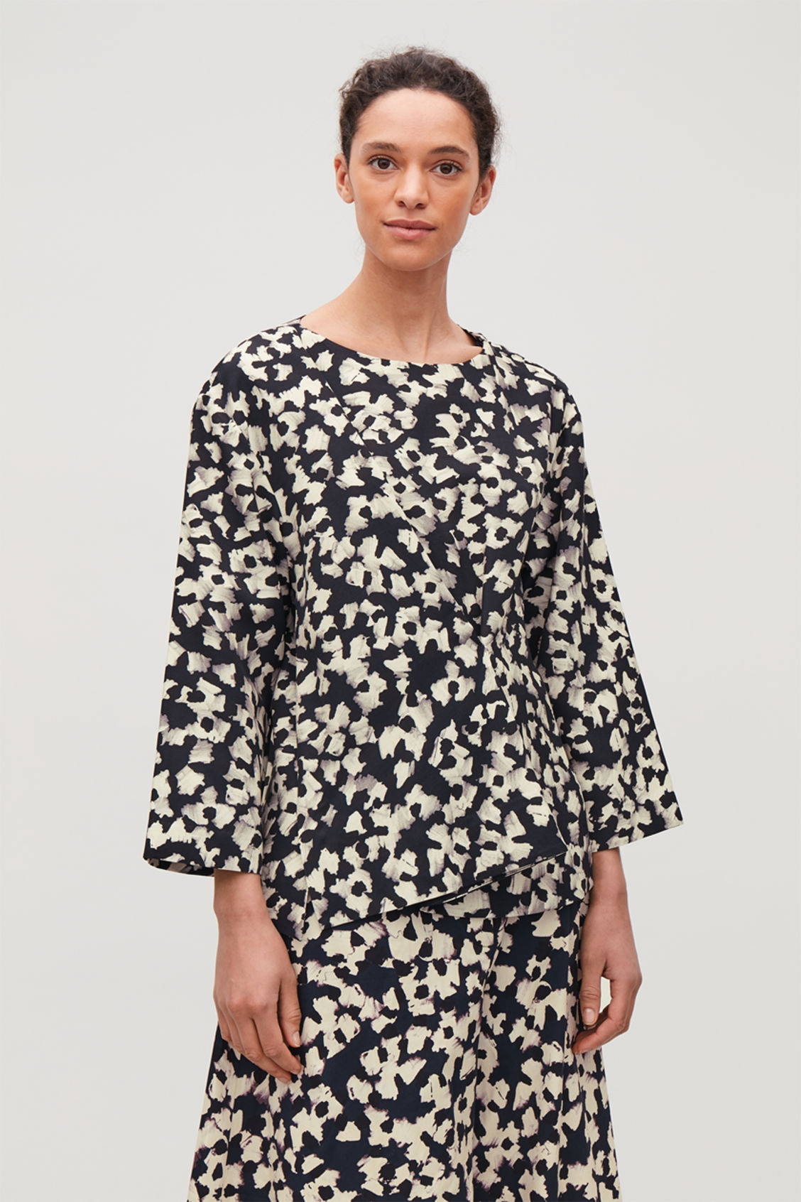 Model side image of Cos pleated abstract-print blouse  in blue