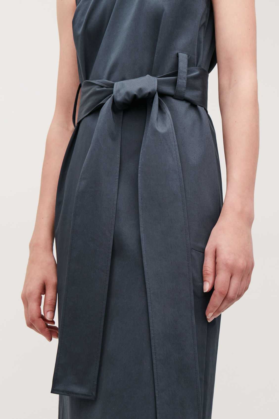 Model side image of Cos belted sleeveless dress in blue