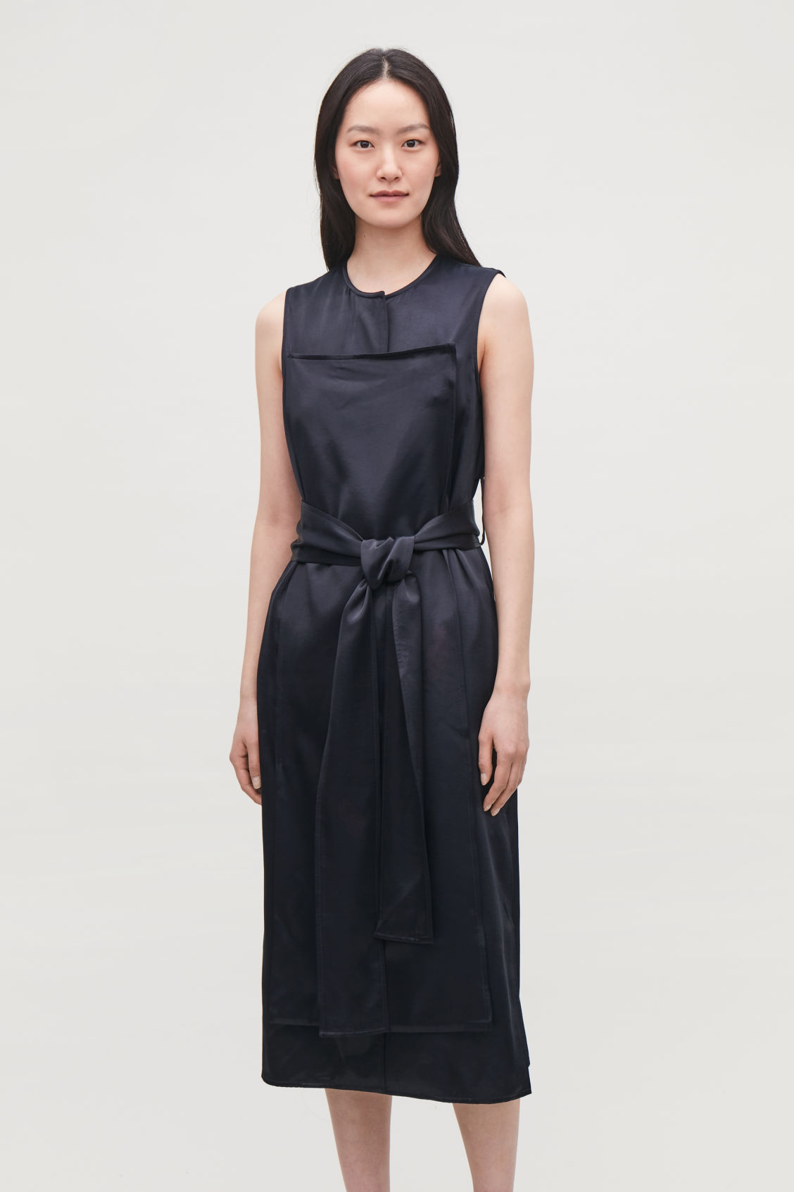 Model side image of Cos trench-detail smooth sleeveless dress in blue