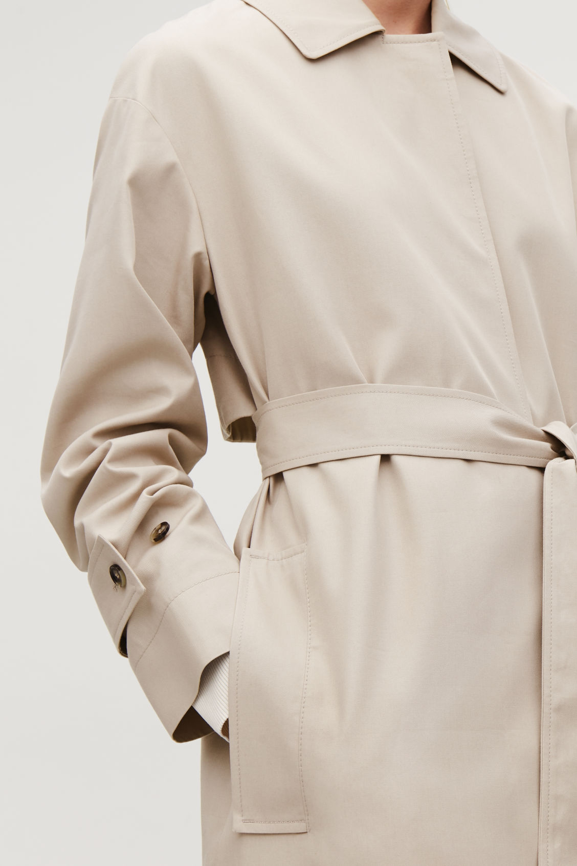 Model side image of Cos organic-cotton trench coat  in beige