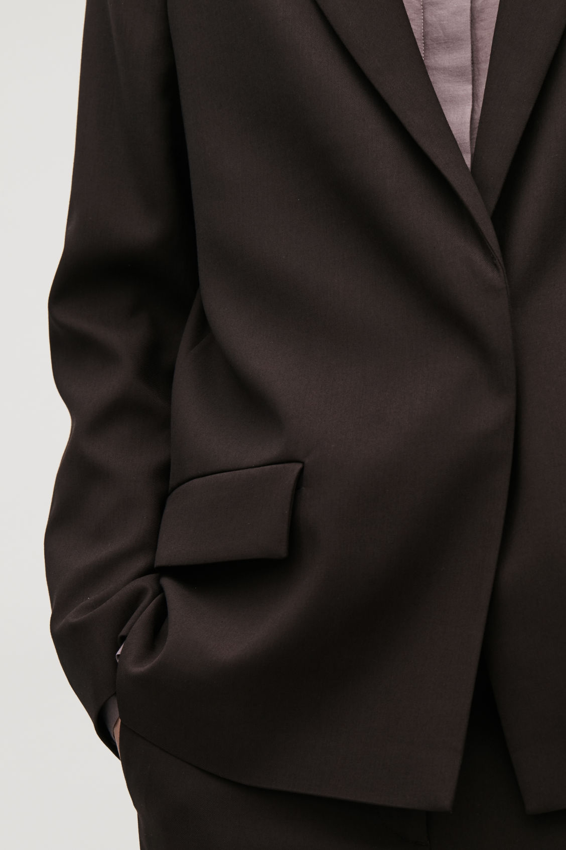 Model side image of Cos vent-detail blazer in brown