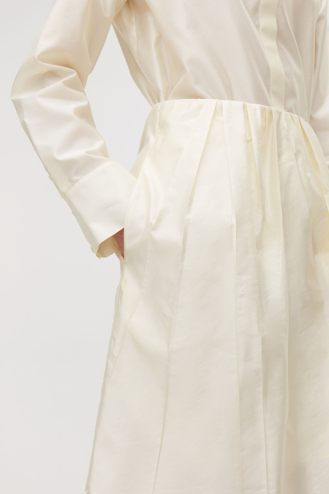 Model side image of Cos pleated silk-blend skirt in beige