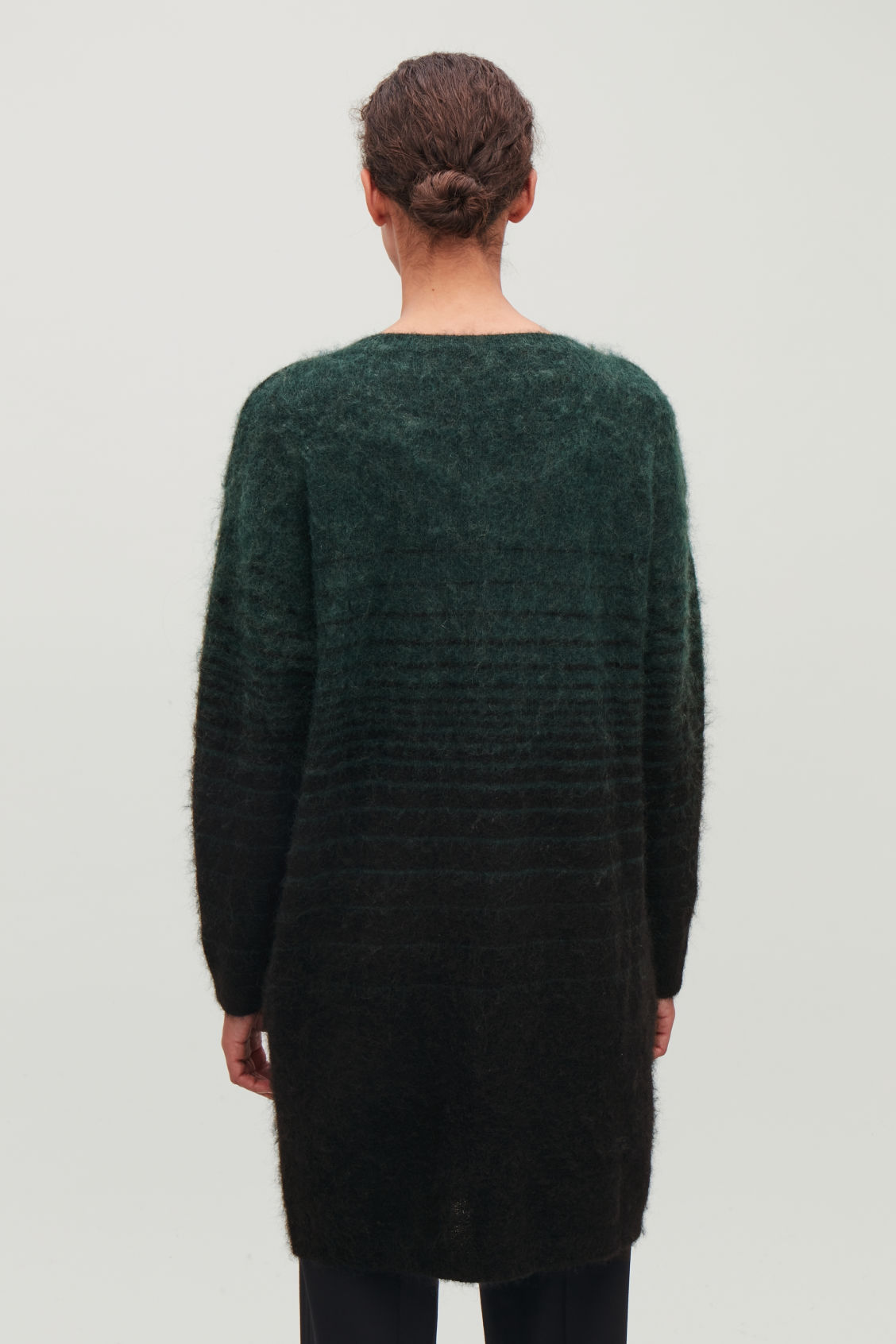 Model side image of Cos straight dress with v-neck in green