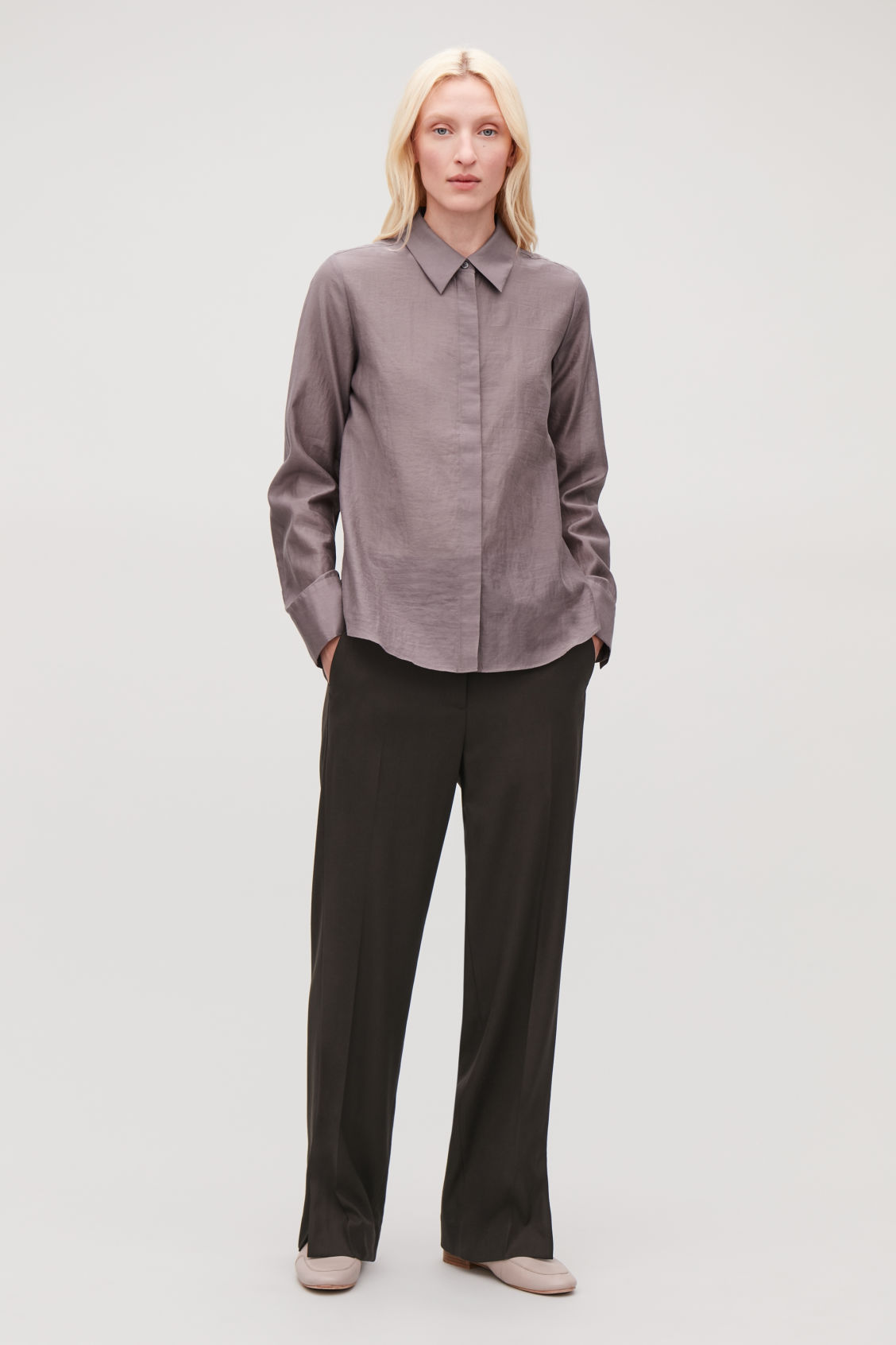 Model front image of Cos vent-detail tailored trousers in brown