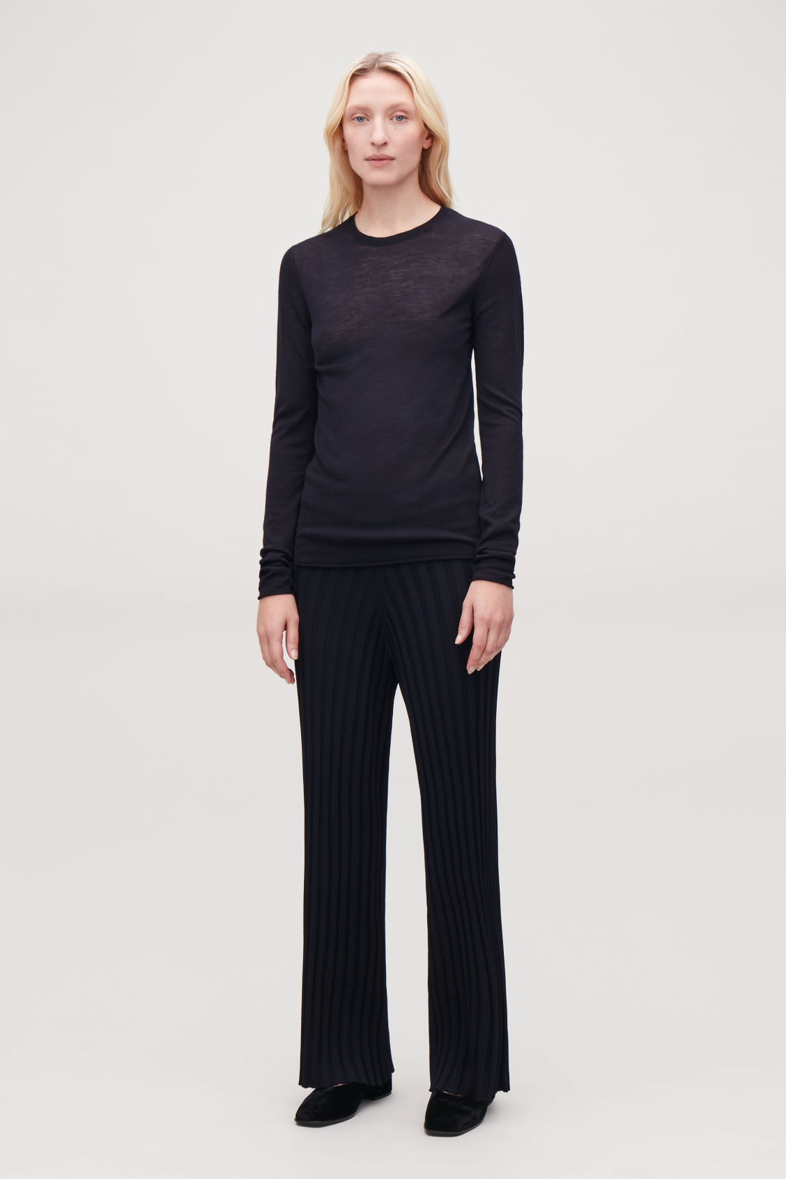 Model front image of Cos ribbed cotton trousers in blue