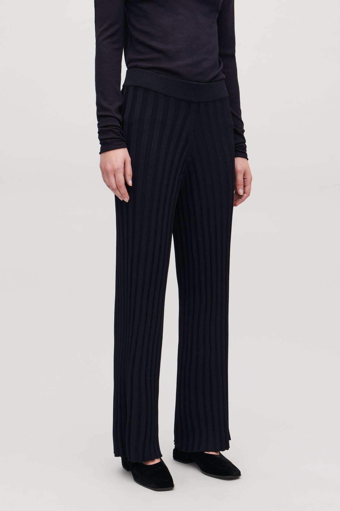 Model side image of Cos ribbed cotton trousers in blue