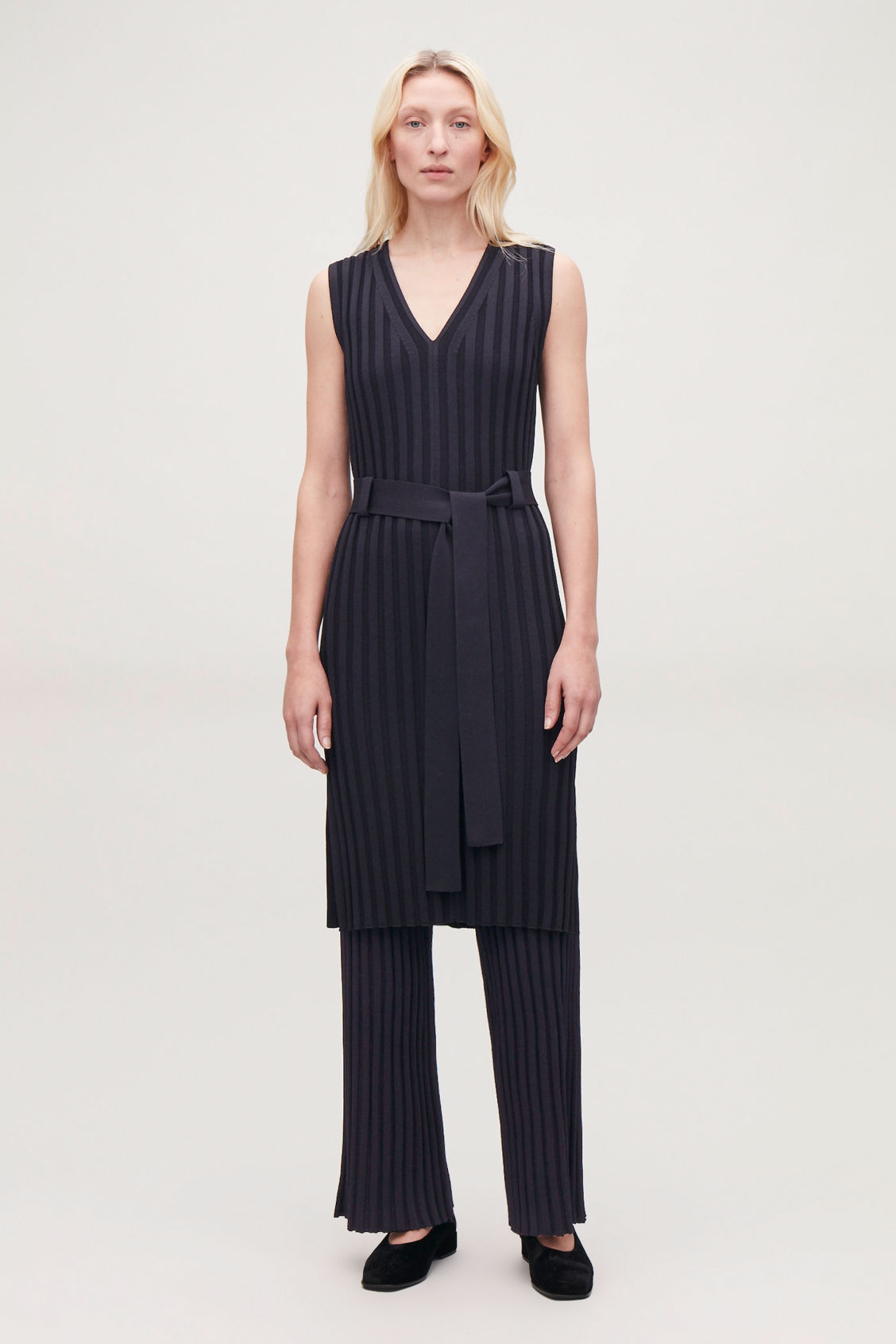 Model side image of Cos ribbed trousers in blue