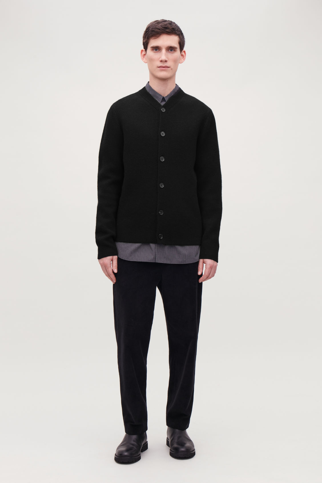 Model front image of Cos lambswool knitted cardigan in black