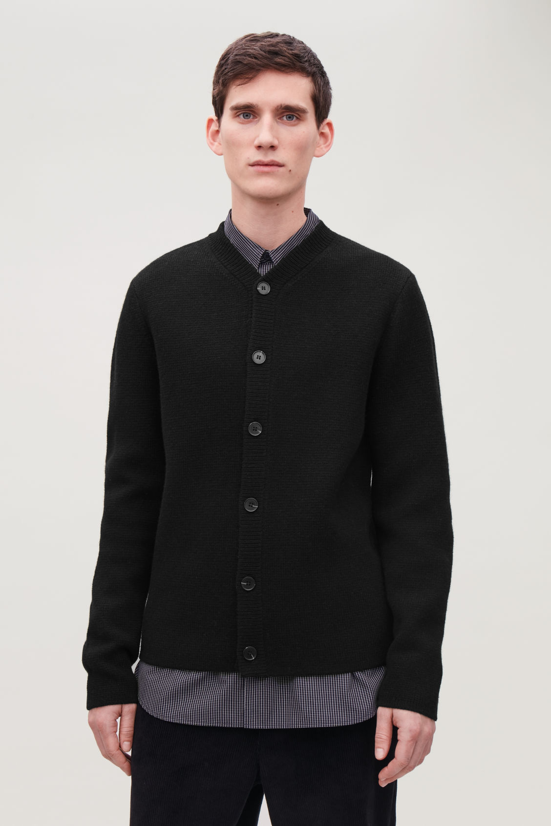 Model side image of Cos lambswool knitted cardigan in black