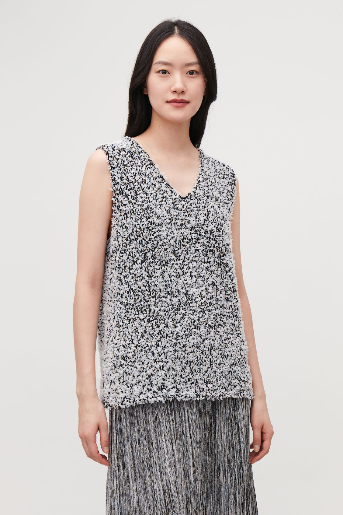 Model side image of Cos sleeveless reverse-knit top in black