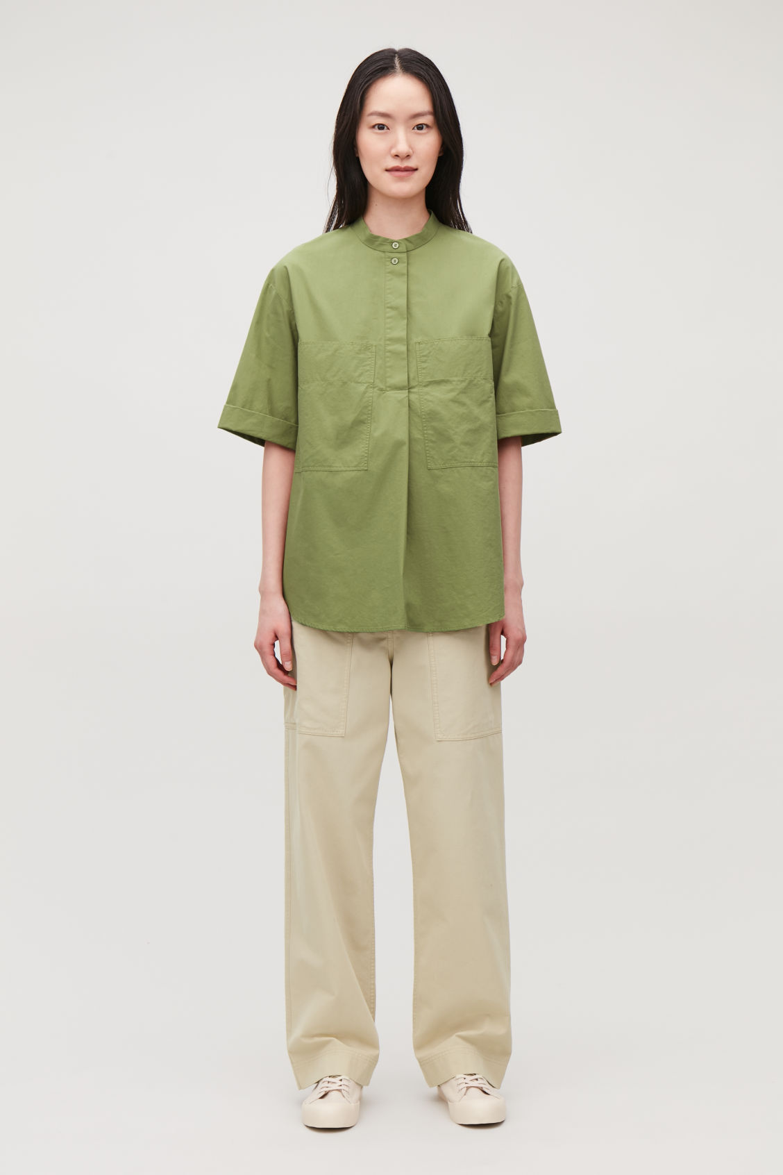 Model front image of Cos patch-pocket cotton a-line shirt in green
