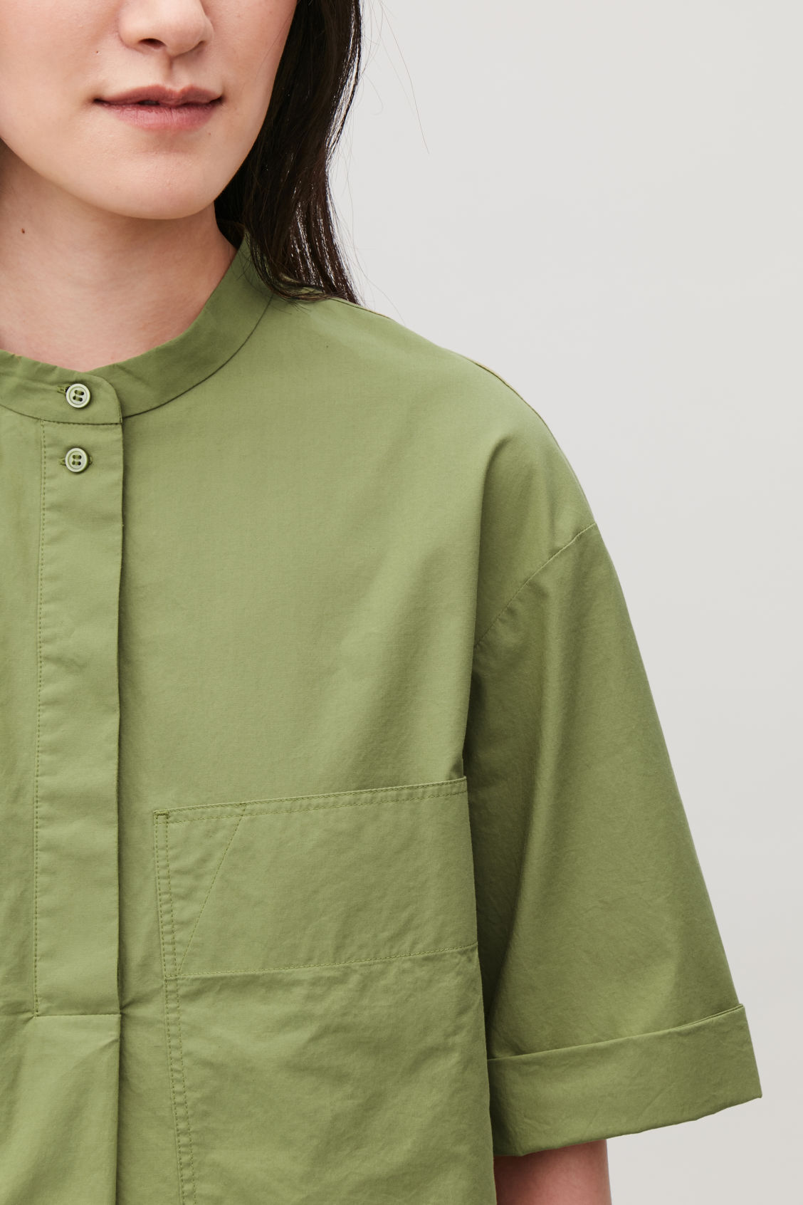 Model side image of Cos patch-pocket cotton a-line shirt in green