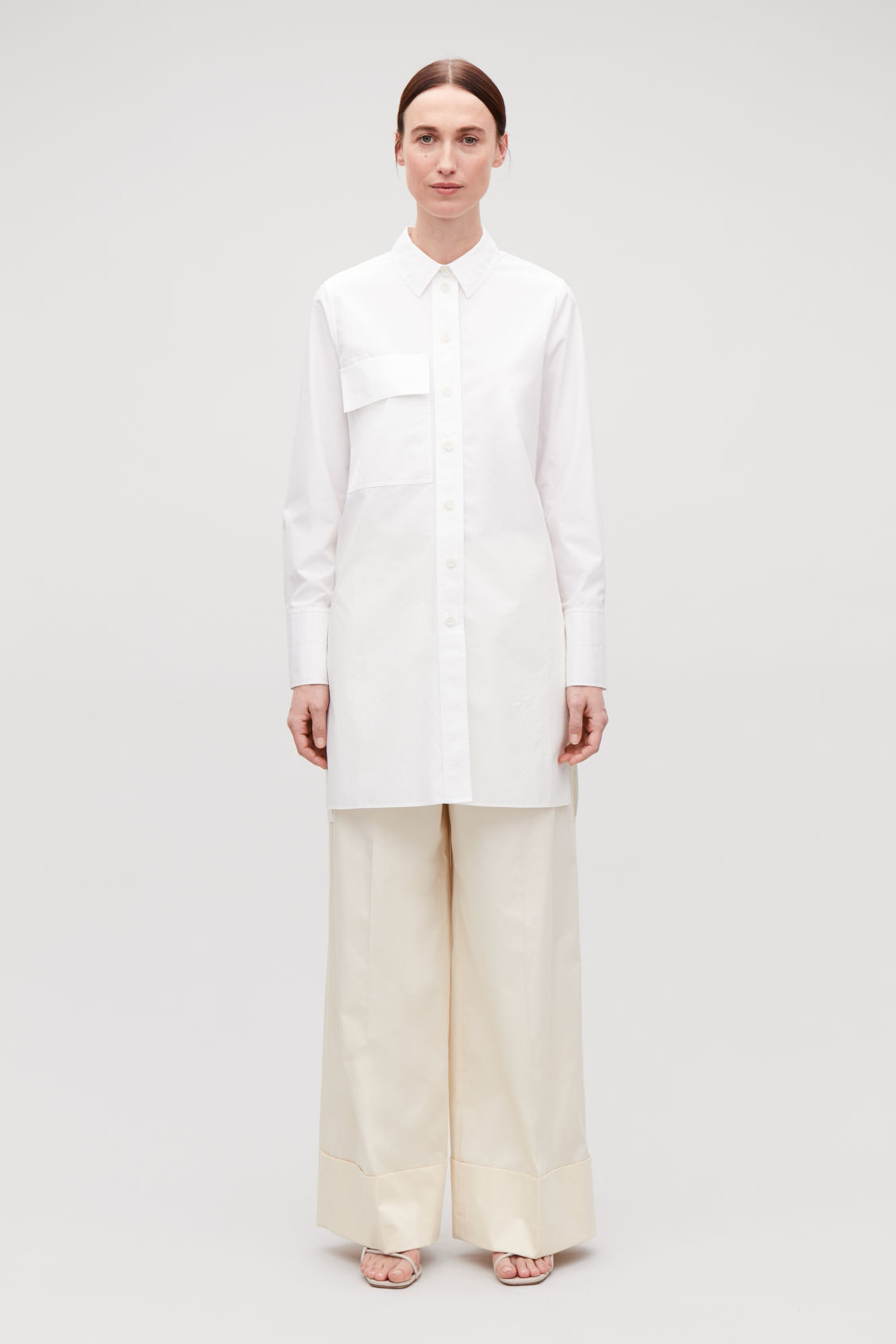 Model front image of Cos long shirt with pocket in white