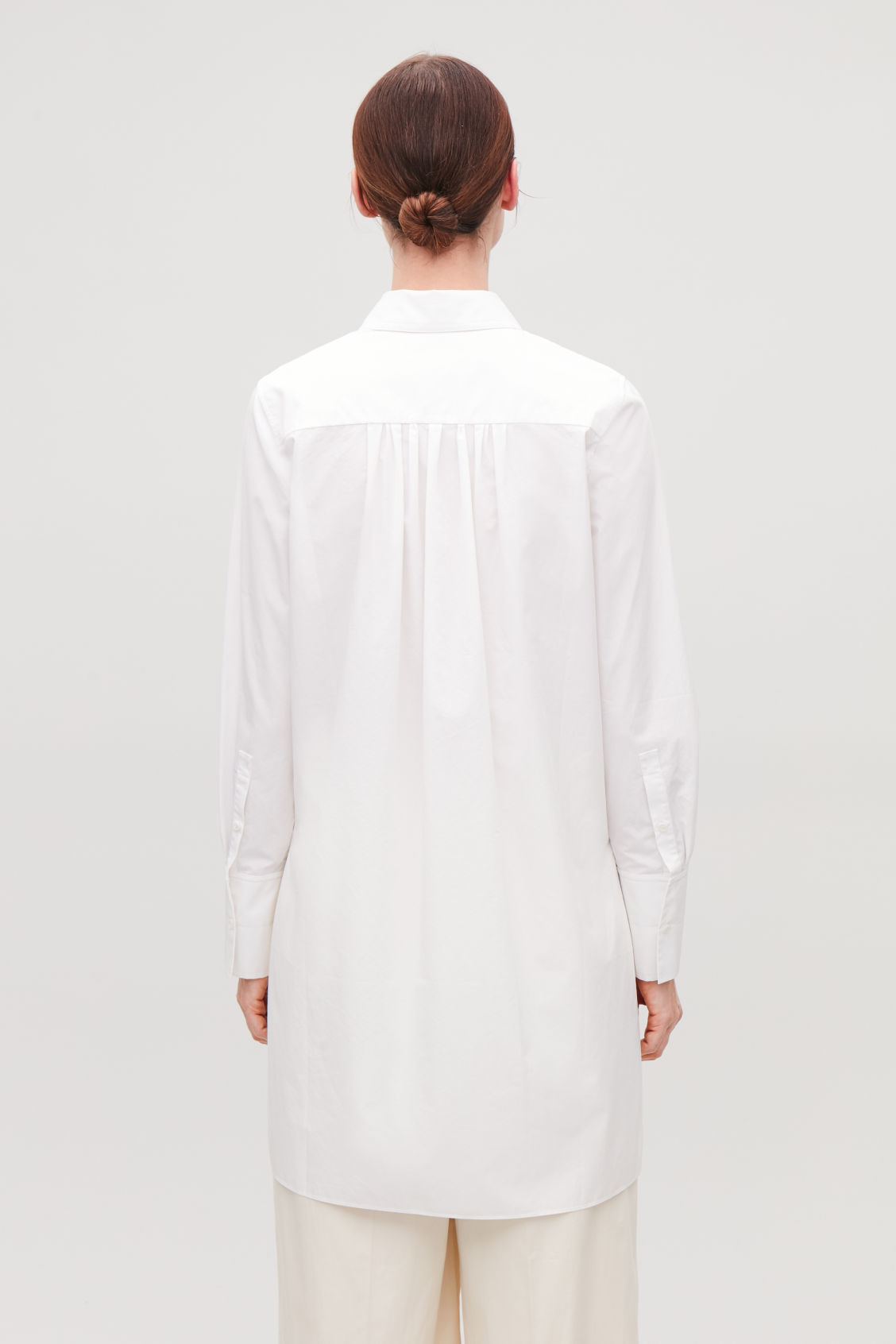 Model side image of Cos long shirt with pocket in white