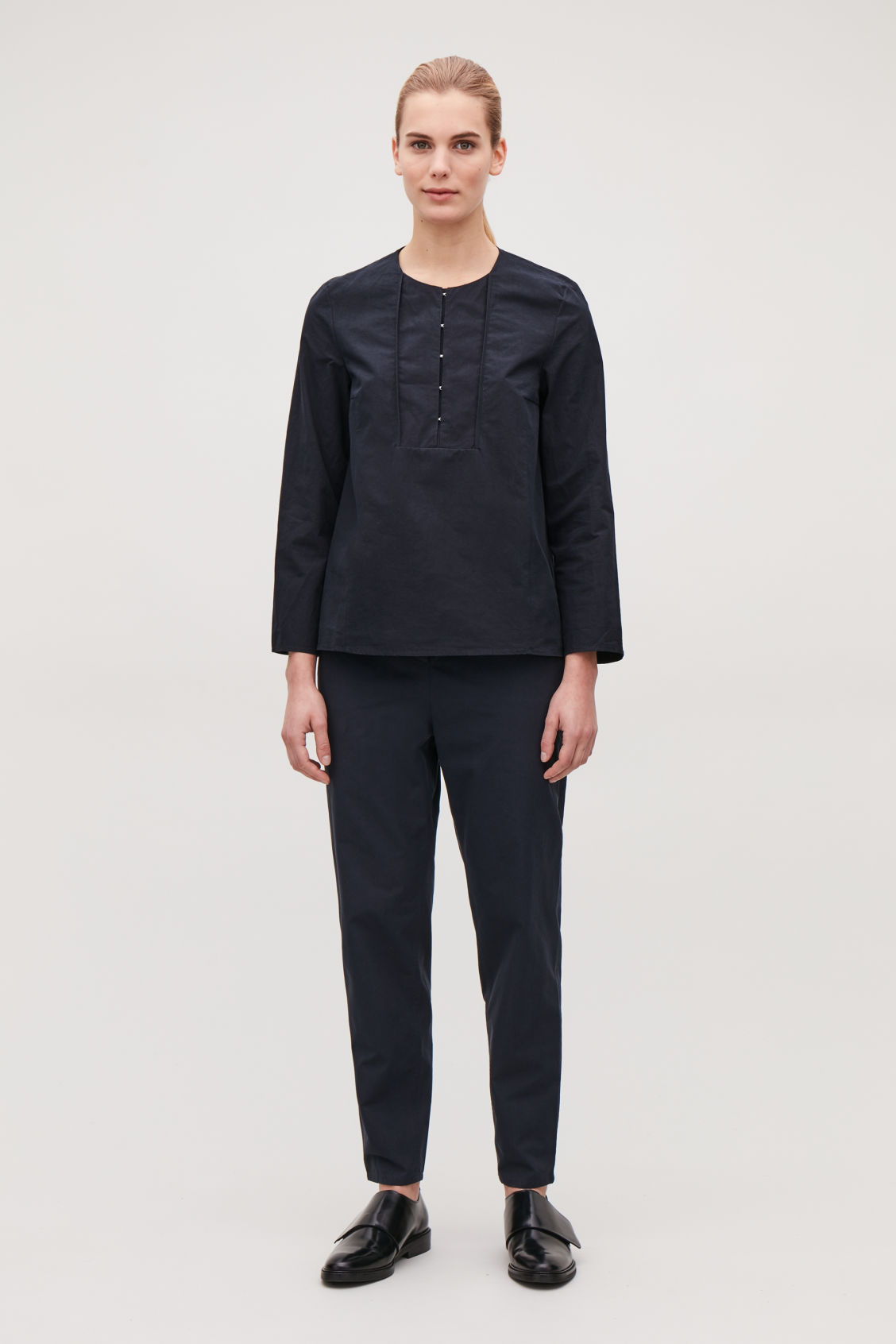 Model front image of Cos hook-fastened poplin blouse in blue