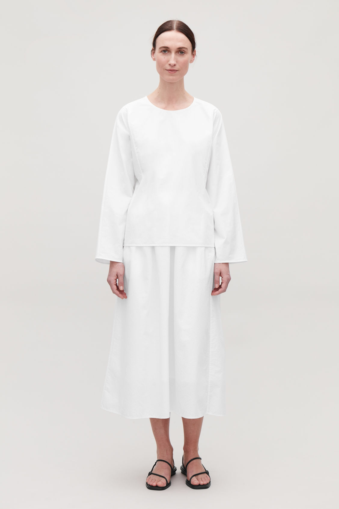 Model front image of Cos cotton boat-neck top in white