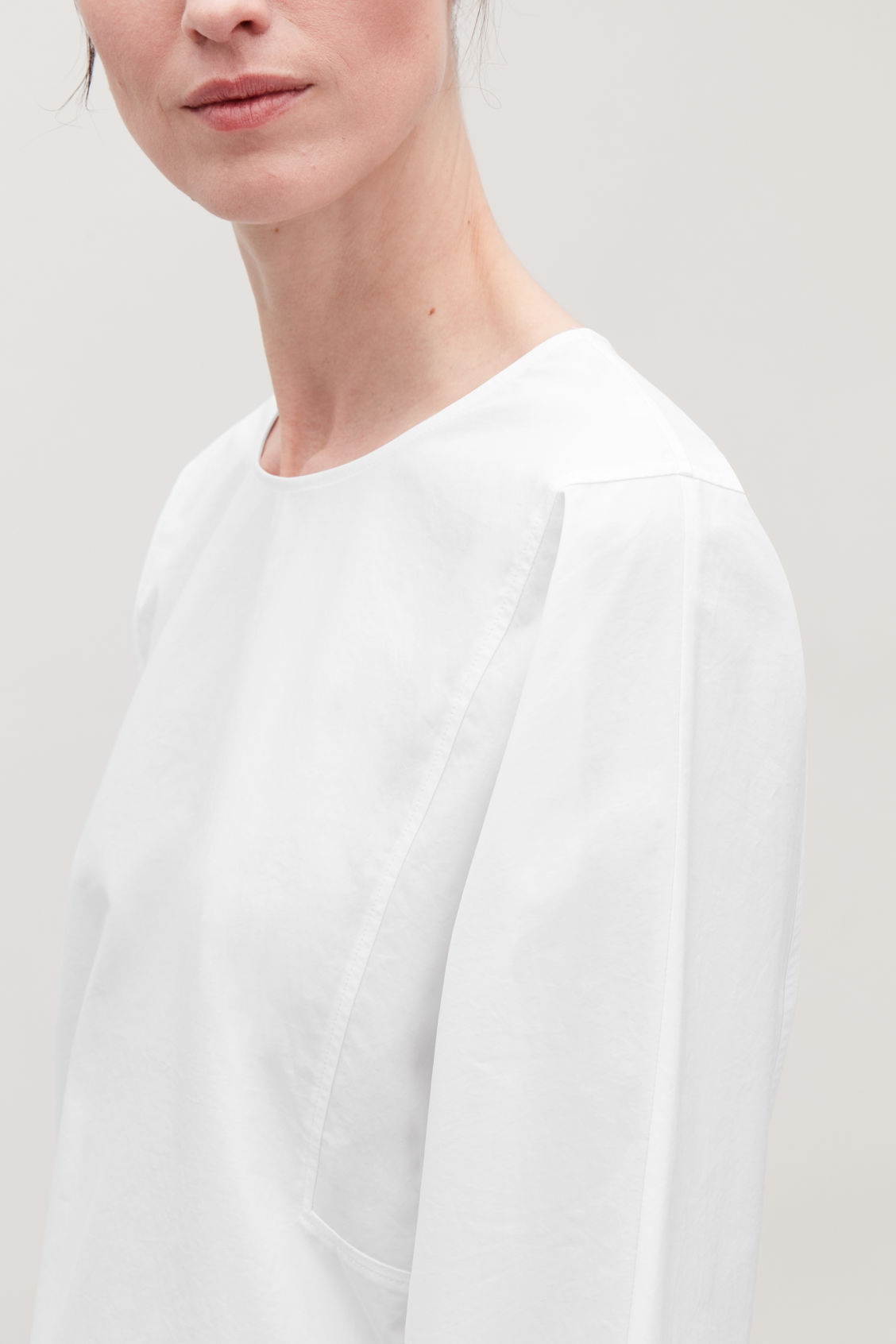 Model side image of Cos cotton boat-neck top in white
