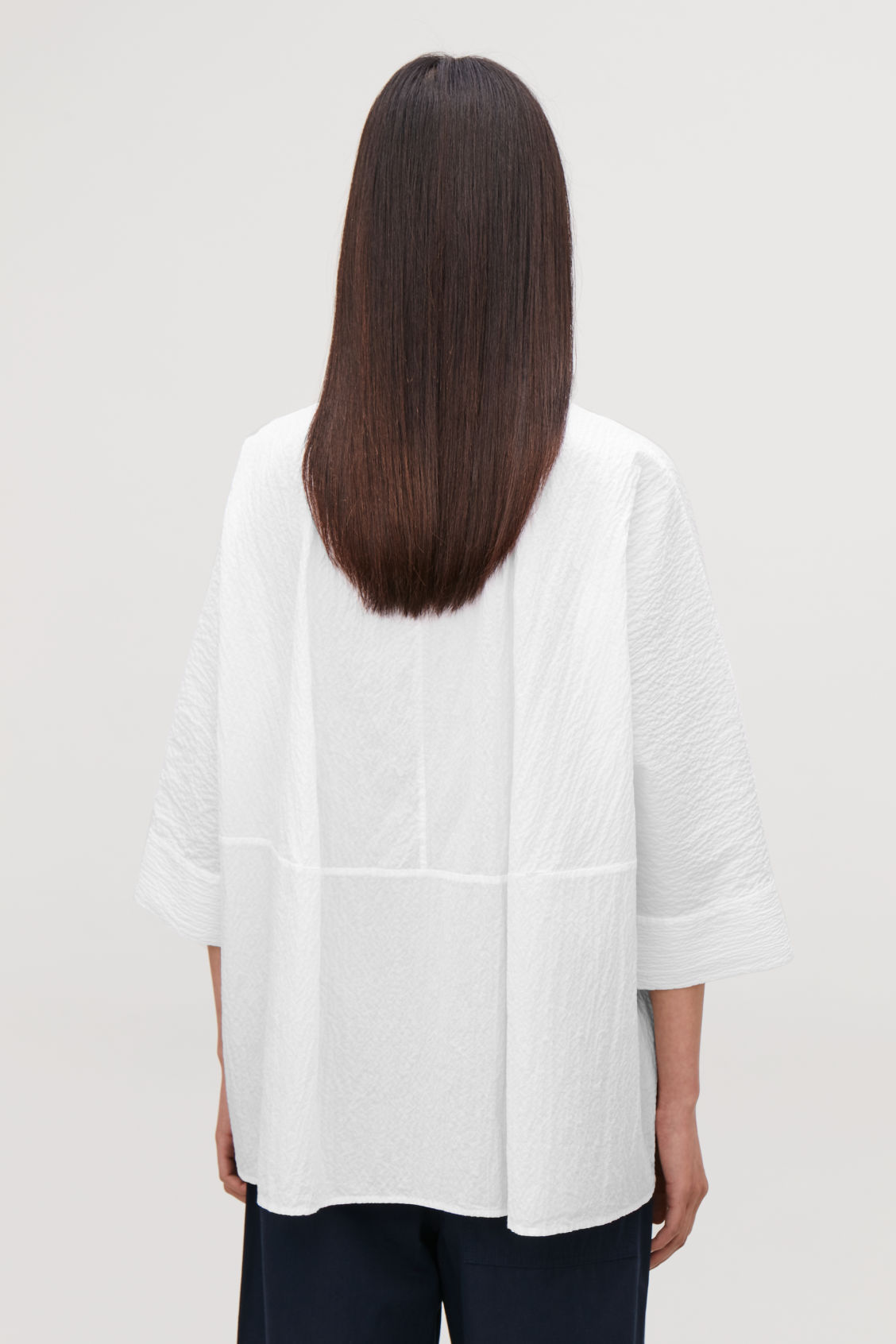 Model side image of Cos loose-fit seersucker shirt  in white