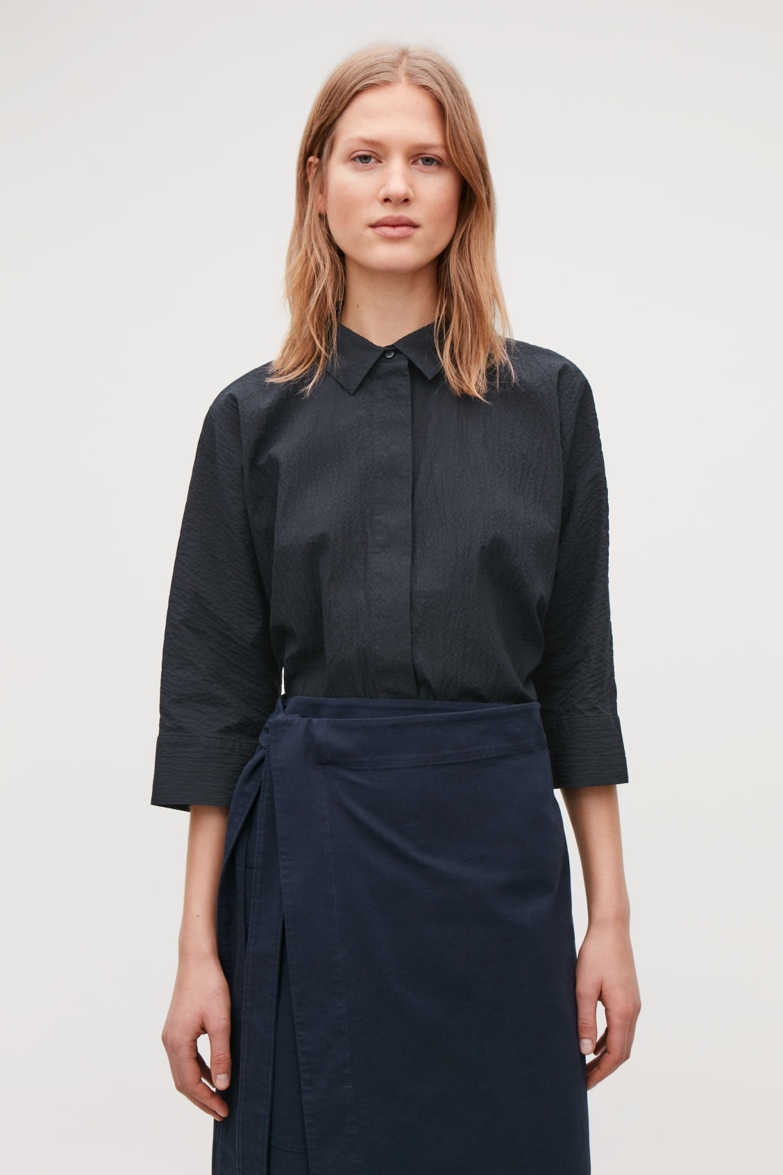 Model side image of Cos loose-fit seersucker shirt  in blue