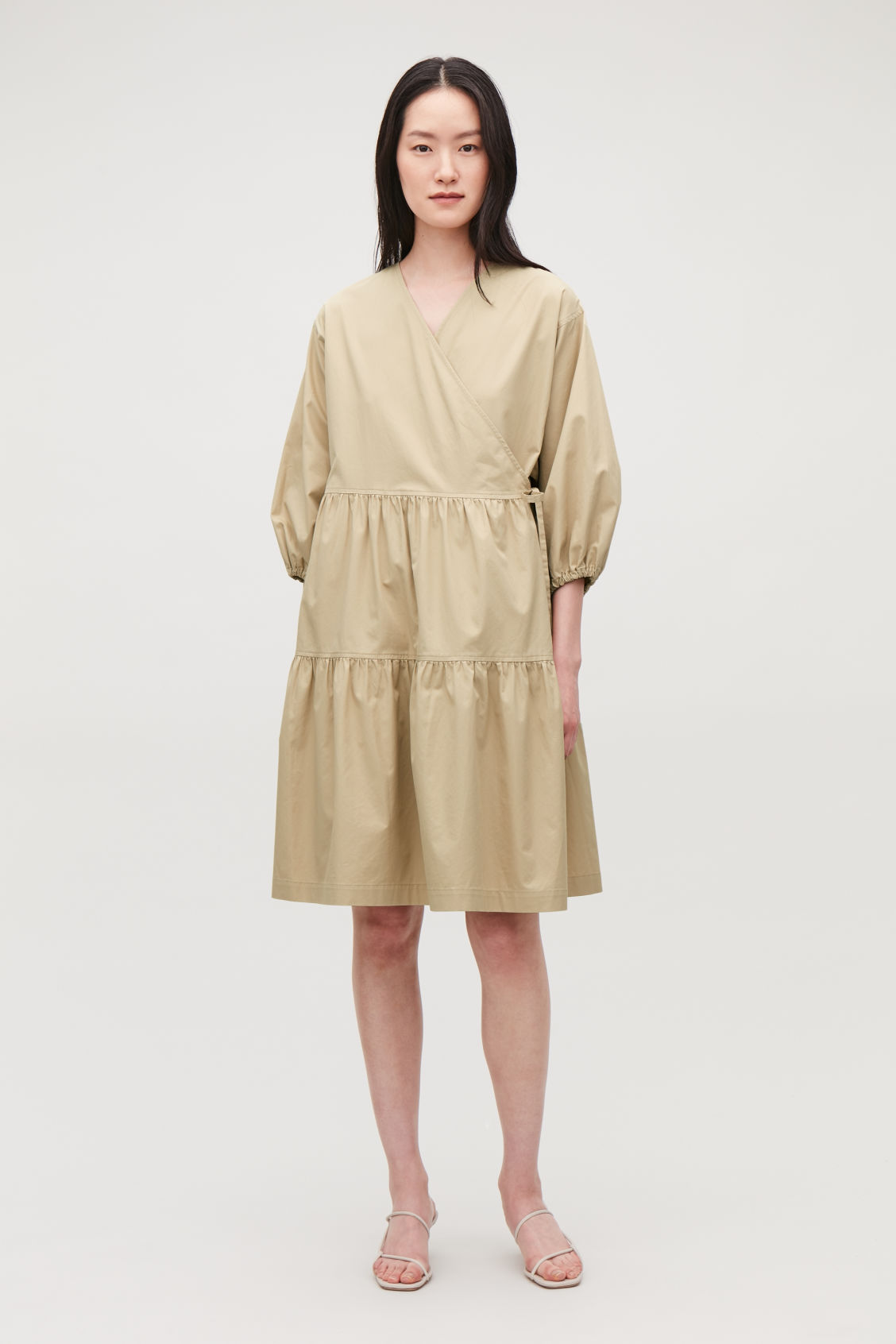Model front image of Cos gathered a-line wrap dress  in beige