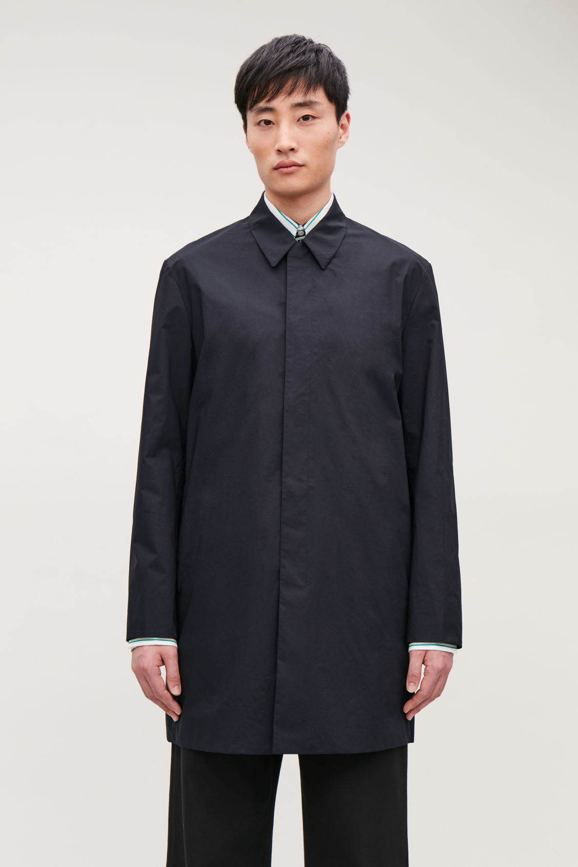 Model side image of Cos lightweight cotton car coat in blue