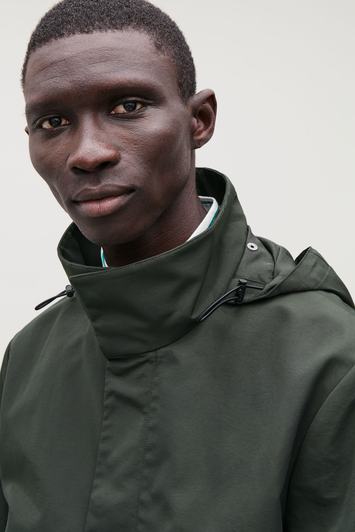 Model side image of Cos light funnel-neck jacket in green