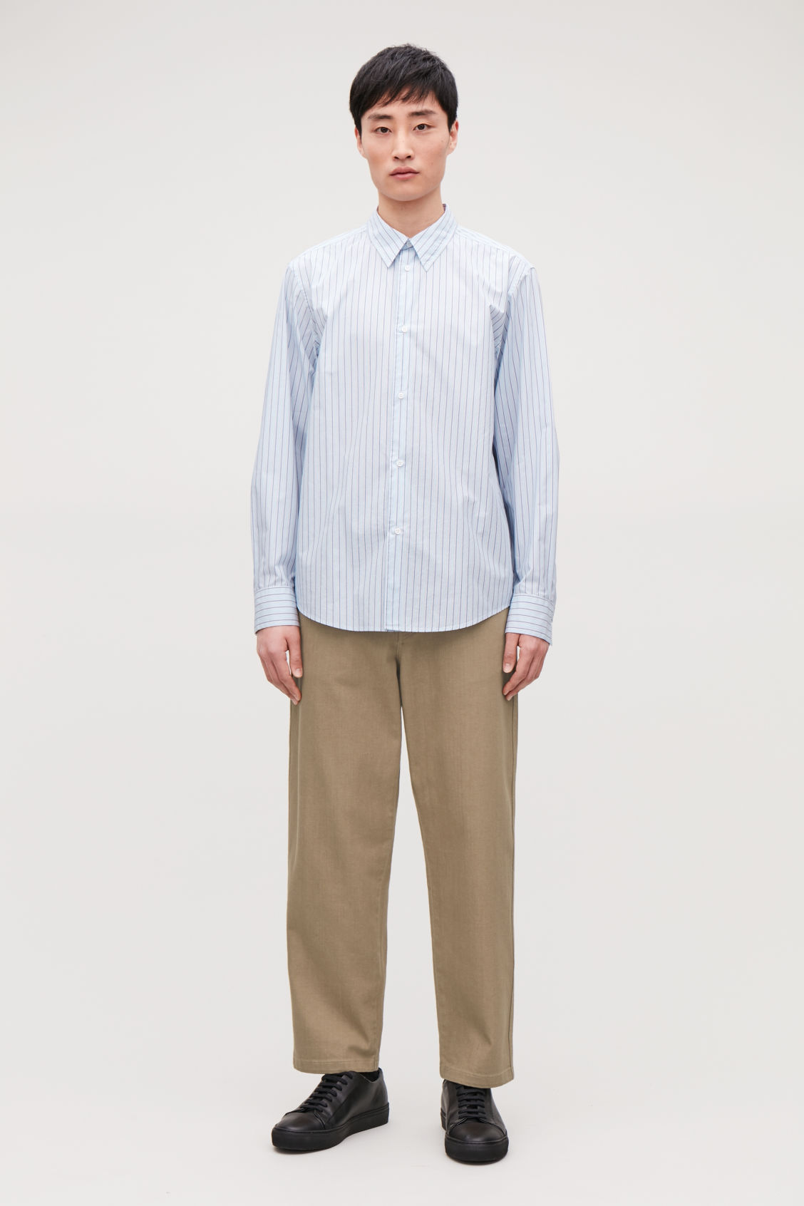Model front image of Cos stepped multi-stripe shirt in blue