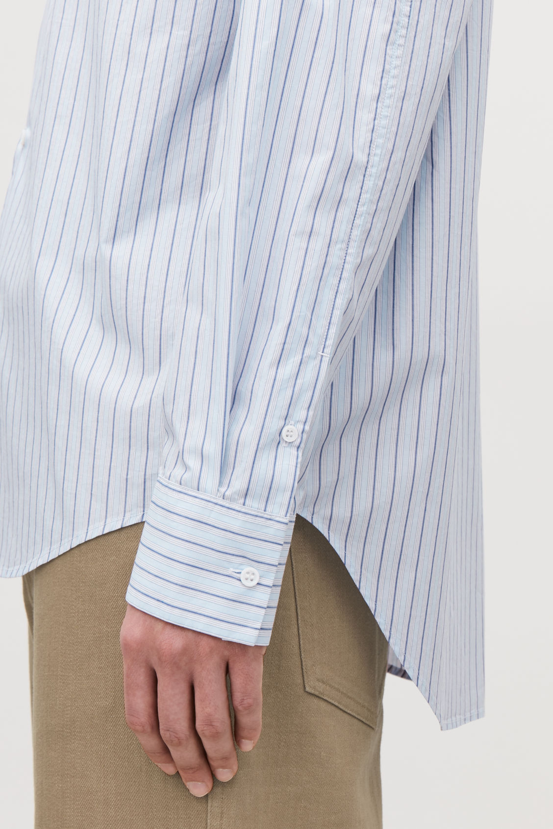 Model side image of Cos stepped multi-stripe shirt in blue