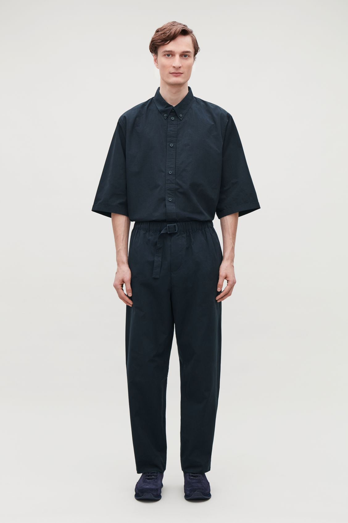 Model front image of Cos relaxed cotton trousers with buckle  in blue
