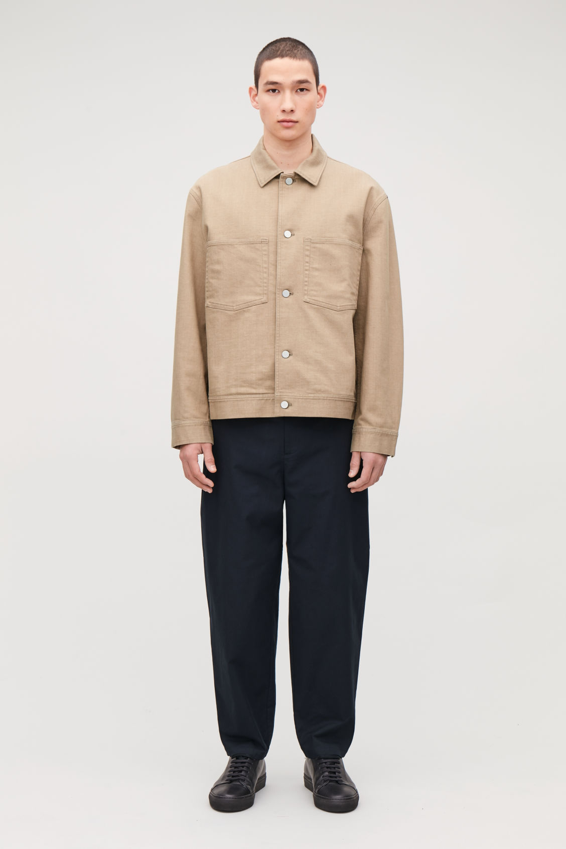 Model side image of Cos wide-leg pleated chinos in blue