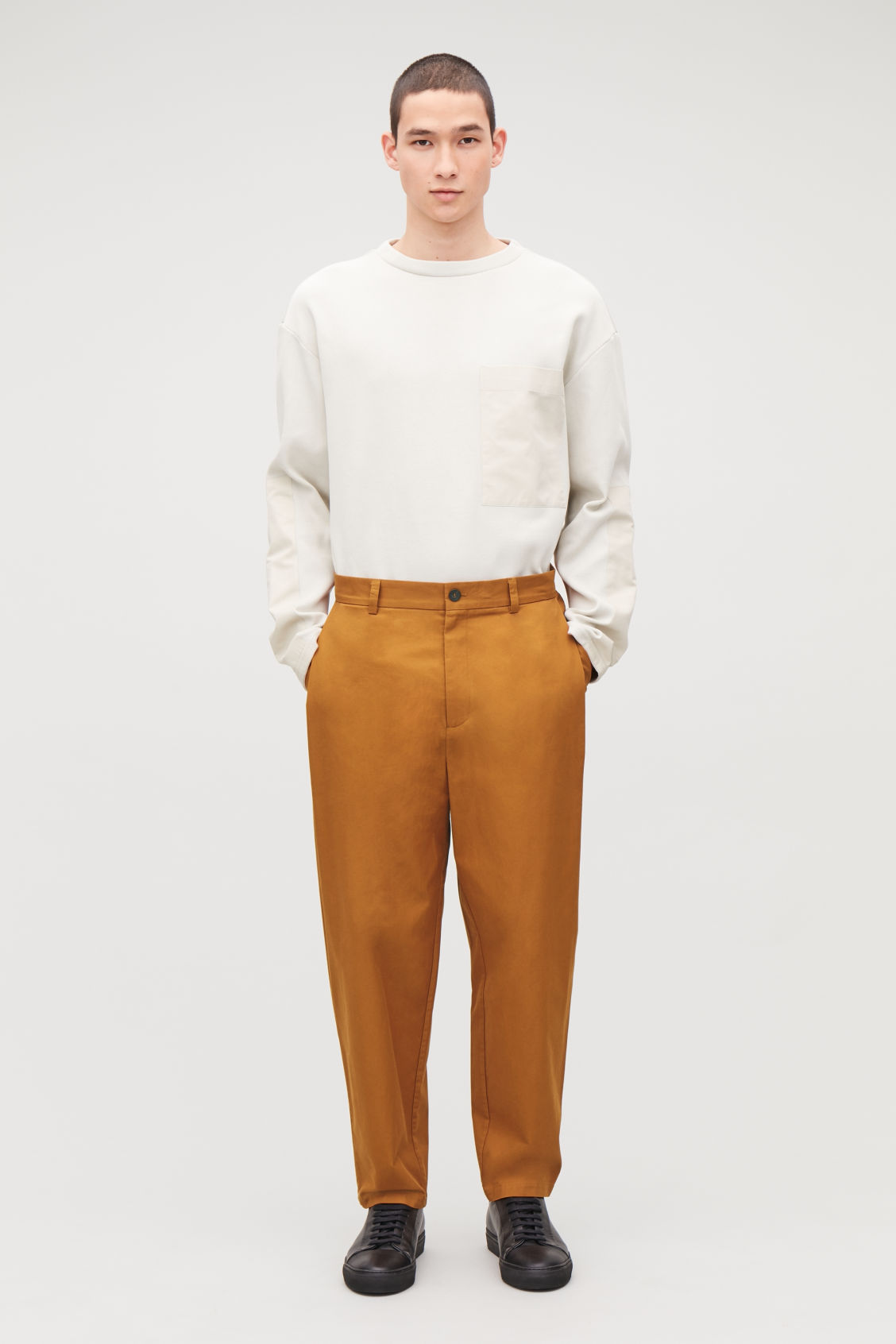 Model front image of Cos wide-leg pleated chinos in orange