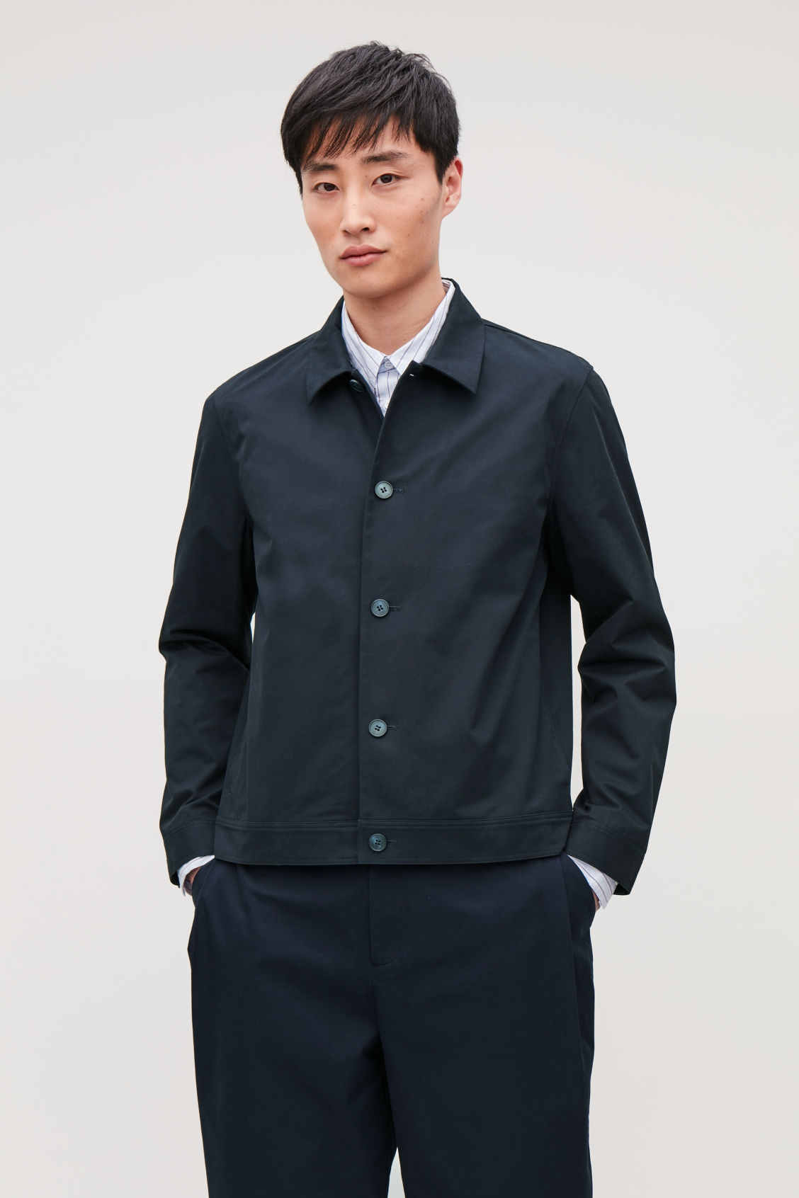 Model side image of Cos button-up shirt jacket in blue