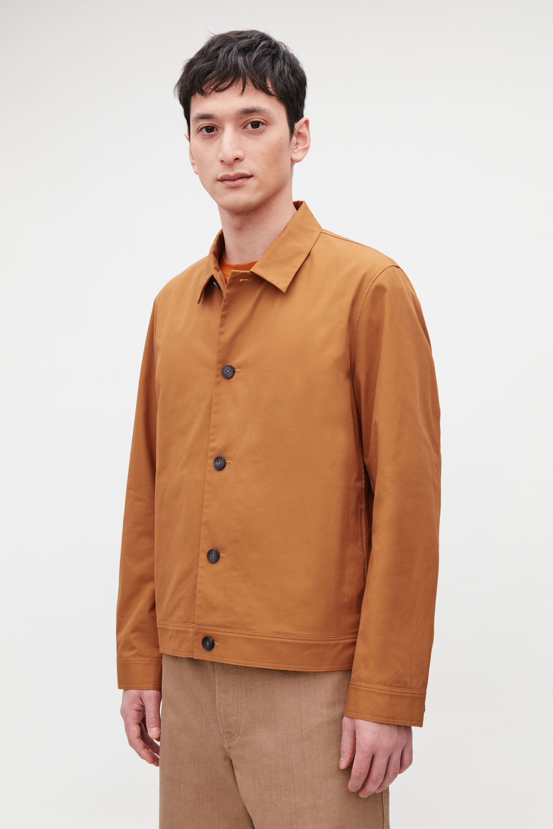 Model side image of Cos button-up shirt jacket in orange