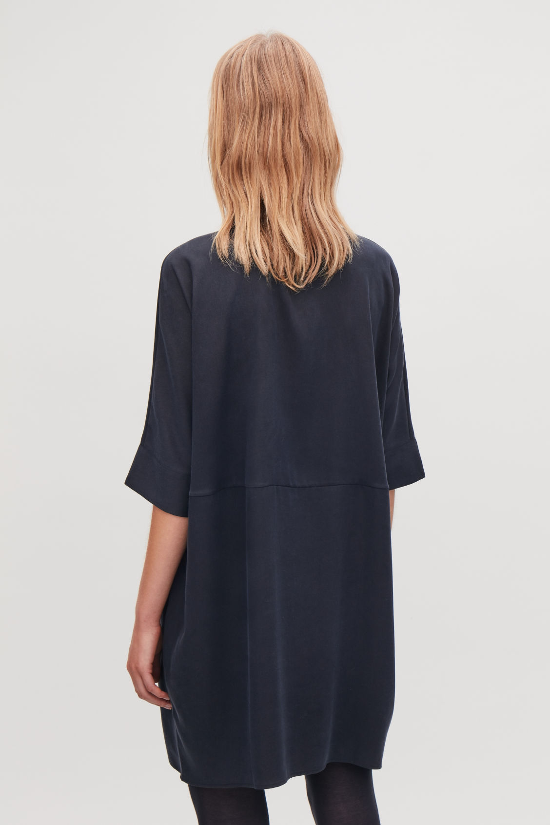 Model side image of Cos boxy shirt dress in blue